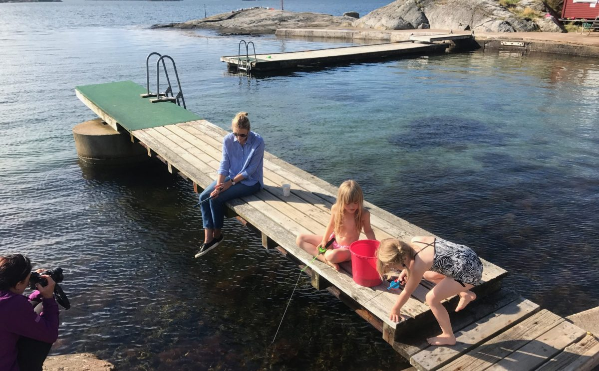 Family fishing for crabs in the archipelago outside Billdal. Meet the with Meet the Locals.