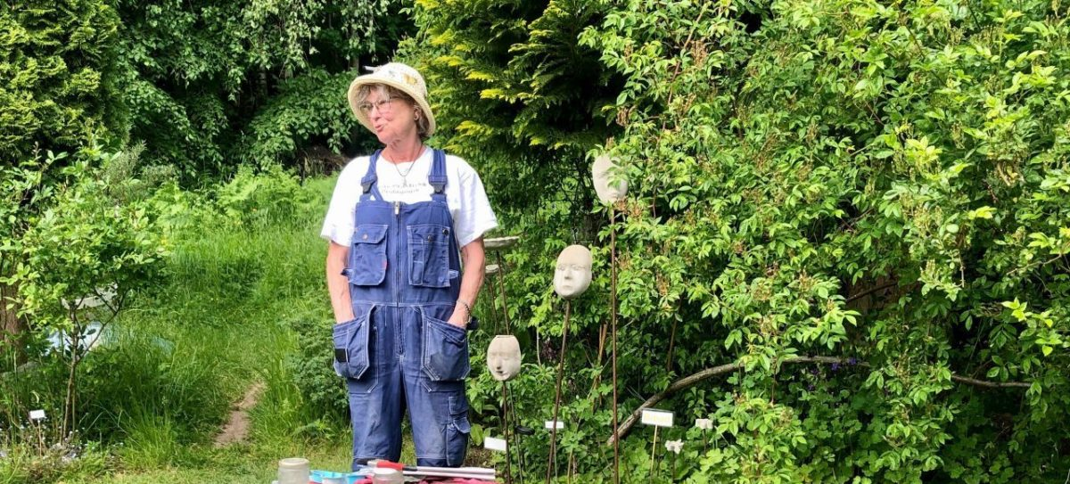 Lady in a garden. In Hyssna Marks County you can visit a private garden with Meet the Locals